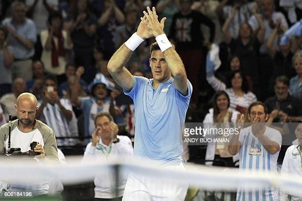TOPSHOT Argentina's Juan Martin del Potro reacts after winning against Britain's Andy Murray during the Davis Cup World Group semifinal singles match...