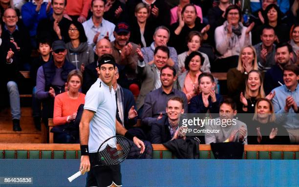 Argentina's Juan Martin Del Potro reacts as he plays against Spain's Fernando Verdasco during the semi final match of the ATP Stockholm Open tennis...