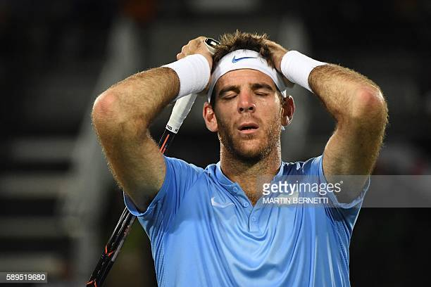 TOPSHOT Argentina's Juan Martin Del Potro reacts during his men's singles gold medal tennis match against Britain's Andy Murray at the Olympic Tennis...