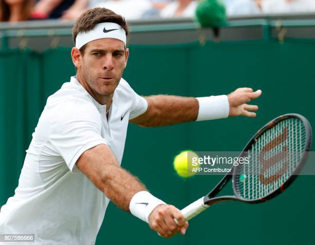 Argentina's Juan Martin del Potro returns against Australia's Thanasi Kokkinakis during their men's singles first round match on the second day of...