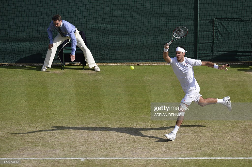 Argentina's Juan Martin Del Potro returns against Italy's Andreas Seppi during their fourth round men's singles match on day seven of the 2013 Wimbledon Championships tennis tournament at the All England Club in Wimbledon, southwest London, on July 1, 2013. Del Potro won 6-4, 7-6, 6-3.