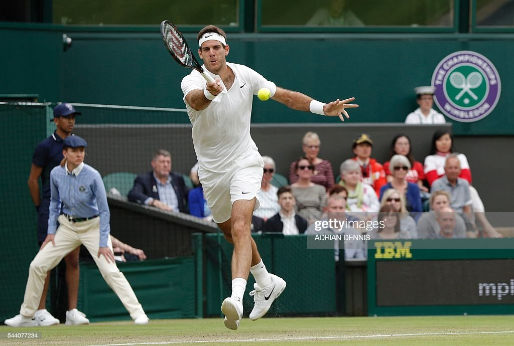 Argentina's Juan Martin del Potro returns to Switzerland's Stan Wawrinka during their men's singles second round match on the fifth day of the 2016 Wimbledon Championships at The All England Lawn Tennis Club in Wimbledon, southwest London, on July 1, 2016. / AFP / ADRIAN