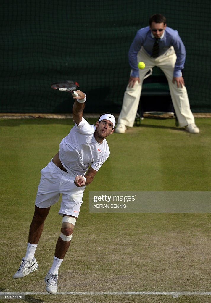 Argentina's Juan Martin Del Potro serves against Italy's Andreas Seppi during their fourth round men's singles match on day seven of the 2013 Wimbledon Championships tennis tournament at the All England Club in Wimbledon, southwest London, on July 1, 2013. Del Potro won 6-4, 7-6, 6-3.