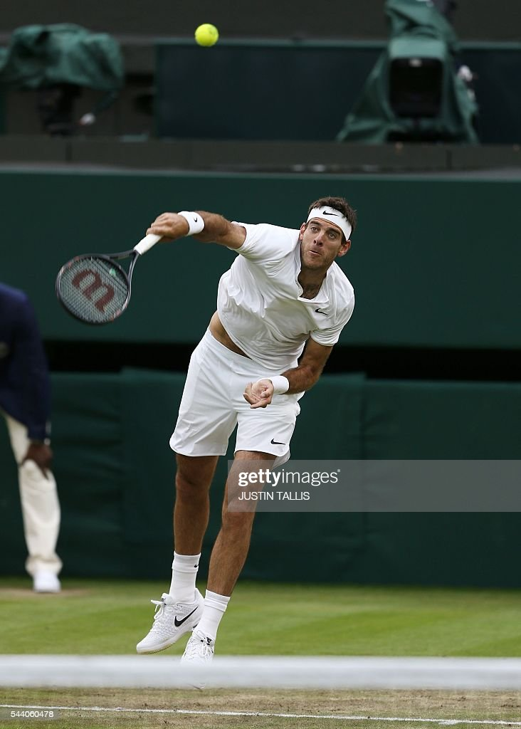 Argentina's Juan Martin del Potro serves to Switzerland's Stan Wawrinka during their men's singles second round match on the fifth day of the 2016 Wimbledon Championships at The All England Lawn Tennis Club in Wimbledon, southwest London, on July 1, 2016. / AFP / JUSTIN