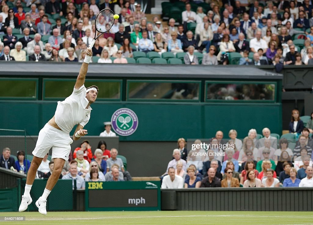 Argentina's Juan Martin del Potro serves to Switzerland's Stan Wawrinka during their men's singles second round match on the fifth day of the 2016 Wimbledon Championships at The All England Lawn Tennis Club in Wimbledon, southwest London, on July 1, 2016. / AFP / ADRIAN