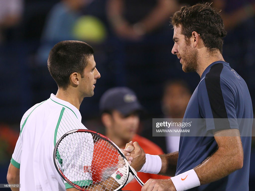 Argentina's Juan Martin Del Potro (R) shakes hands with to World number one Serbia's Novak Djokovicat the end of their ATP Dubai Open tennis semi-final match in the Gulf emirate on March 1, 2013. Djokovic won the match 6-3, 7-6.