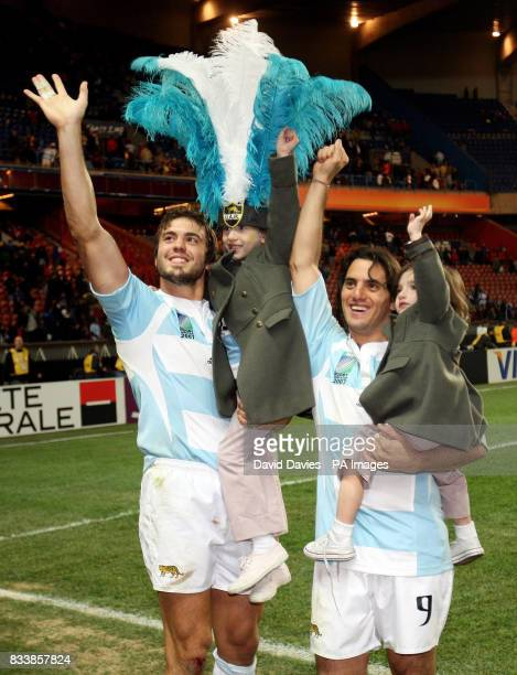 Argentina's Juan Martin Hernandez and Agustin Pichot celebrate during the IRB Rugby World Cup Bronze Medal match at Parc des Princess Paris France