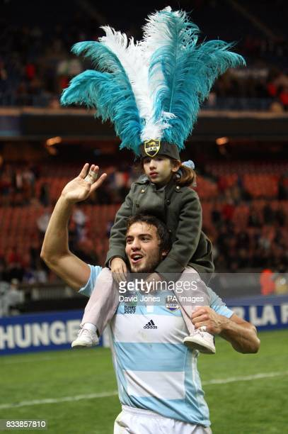 Argentina's Juan Martin Hernandez celebrates victory with his daughter after the final whistle