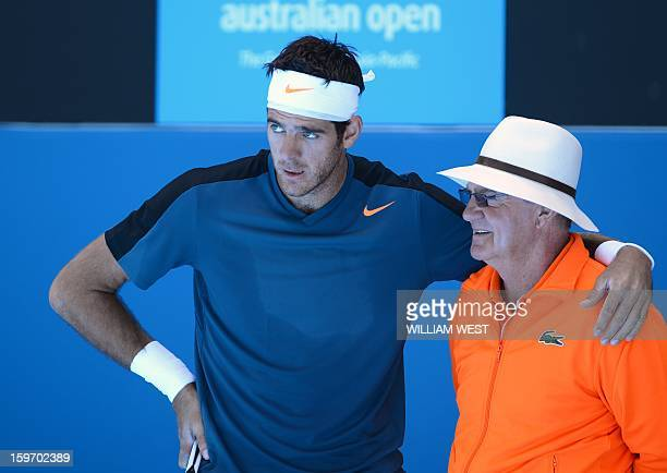 Argentina's Juan Martín Del Potro rests on a linesman after a point during his men's singles match against France's Jeremy Chardy on day six of the...