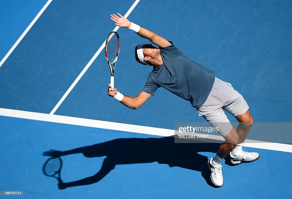Argentina's Juan Martín Del Potro serves against France's Jeremy Chardy during their men's singles match on day six of the Australian Open tennis tournament in Melbourne on January 19, 2013.