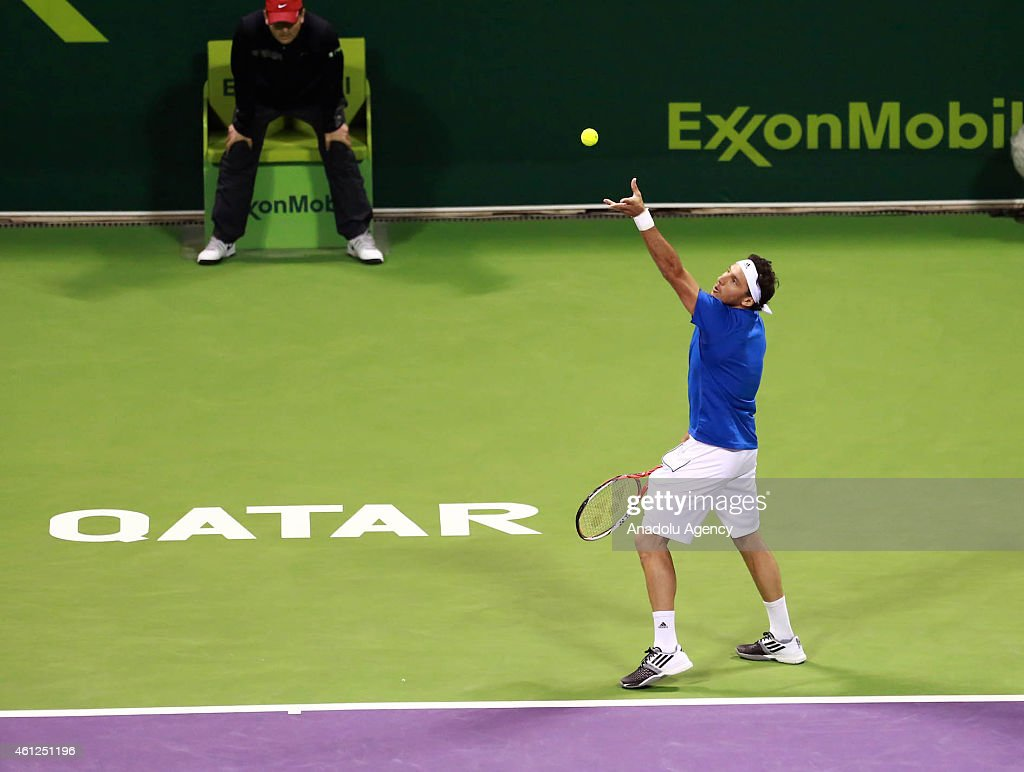Argentina's Juan Monaco partnered by Spain's Rafael Nadal (not seen) serves the ball to Austria's Julian Knowle and Philipp Oswald during their men's doubles final match at the Qatar ExxonMobil Open tennis tournament at the Khalifa Tennis Complex in Doha, Qatar on January 09, 2015.