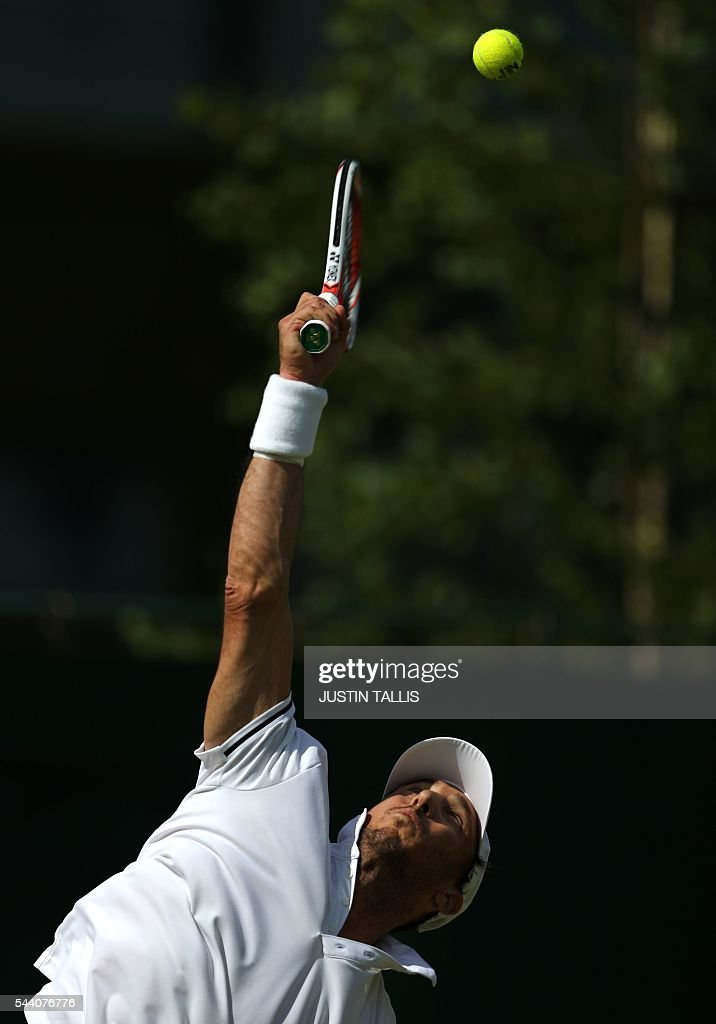 Argentina's Juan Monaco serves to France's Jo-Wilfried Tsonga during their men's singles second round match on the fifth day of the 2016 Wimbledon Championships at The All England Lawn Tennis Club in Wimbledon, southwest London, on July 1, 2016. / AFP / JUSTIN