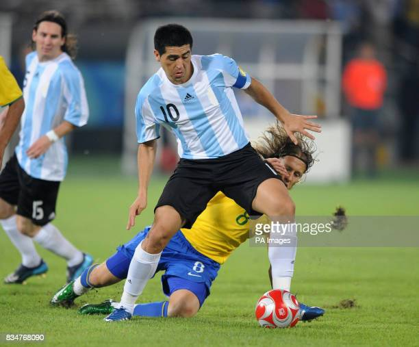 Argentina's Juan Riquelme and Brazil's Lucas in the Men's Semi Final at the Workers Stadium in Beijing China