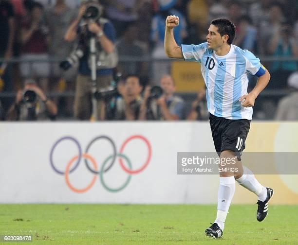 Argentina's Juan Riquelme celebrates scoring his sides third goal of the game