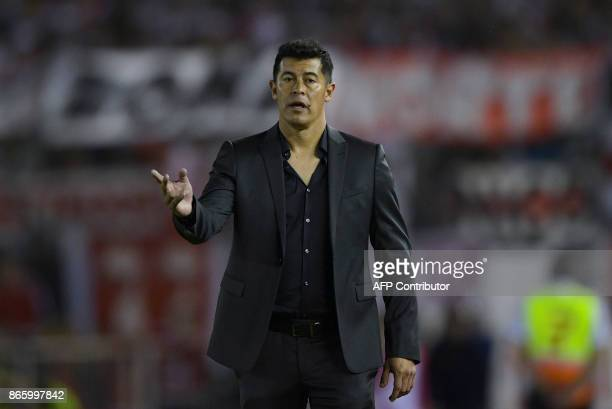 Argentina's Lanus coach Jorge Almiron gestures during the 2017 Copa Libertadores semifinal first leg football match against River Plate at the...
