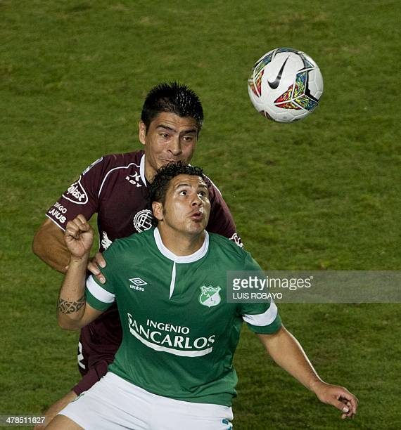 Argentina's Lanus defender Paolo Goltz vies for the ball with Colombian Deportivo Cali's forward Robin Ramirez during their Libertadores Cup second...