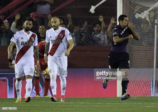 Argentina's Lanus forward Jose Sand celebrates after scoring his team's second goal against Argentina's River Plate during their Copa Libertadores...