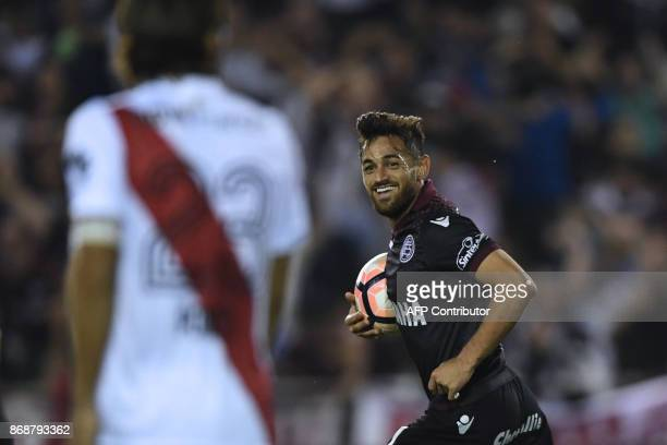 Argentina's Lanus forward Lautaro Acosta celebrates after scoring against Argentina's River Plate during their Copa Libertadores semifinal second leg...