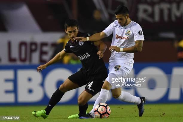 Argentina's Lanus midfielder Matias Rojas vies for the ball with Venezuela's Zulia midfielder Junior Moreno during the Copa Libertadores 2017...
