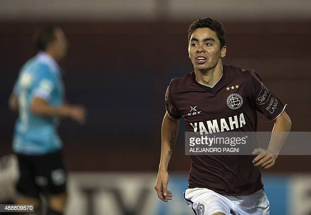 Argentina's Lanus midfielder Miguel Almiron celebrates after scoring the team's fourth goal against Argentina's Belgrano during a Copa Sudamericana...