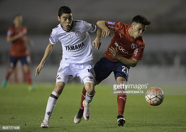 Argentina's Lanus midfielder Miguel Almiron vies for the ball with Argentina's Independiente forward Ezequiel Barco during their Copa Sudamericana...