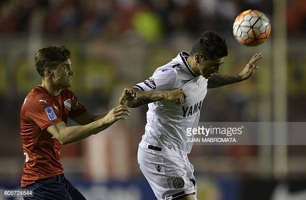 Argentina's Lanus midfielder Roman Martinez vies for the ball with Argentina's Independiente defender Nicolas Tagliafico during their Copa...
