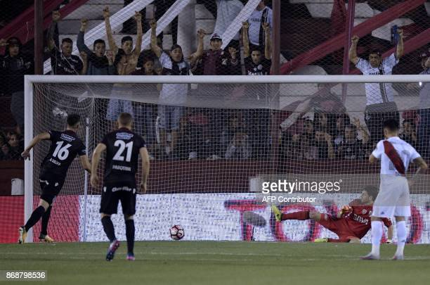 Argentina's Lanus Uruguayan defender Alejandro Silva scores a penalty against Argentina's River Plate during their Copa Libertadores semifinal second...