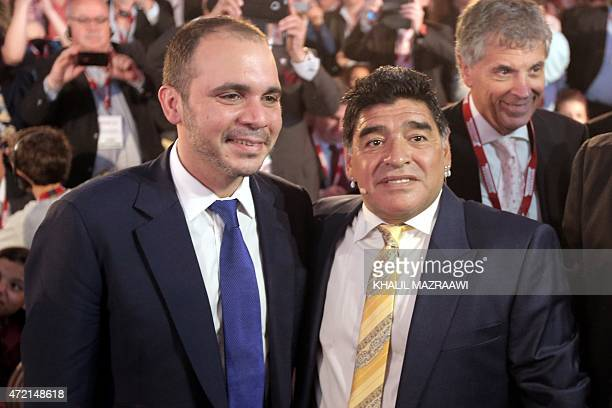 Argentina's legendary exfootballer Diego Maradona poses next to FIFA vice president and candidate for the presidency Jordan's Prince Ali bin...