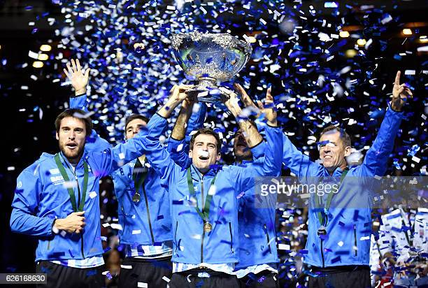 Argentina's Leonardo Mayer Federico Delbonis Guido Pella Federico Delbonis Juan martin del Potro and coach Daniel Orsanic celebrate with the trophy...
