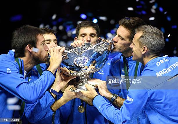 Argentina's Leonardo Mayer Guido Pella Federico Delbonis Juan martin del Potro and coach Daniel Orsanic celebrate with the trophy after winning the...