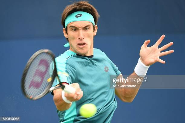 Argentina's Leonardo Mayer returns the ball to France's Richard Gasquet during their Qualifying Men's Singles match at the 2017 US Open Tennis...
