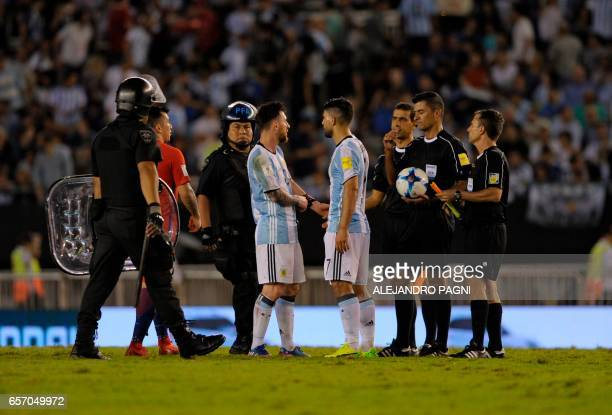 Argentina's Lionel Messi and Argentina's Sergio Aguero speak with Brazilian referee Sandro Ricci during their 2018 FIFA World Cup qualifier football...