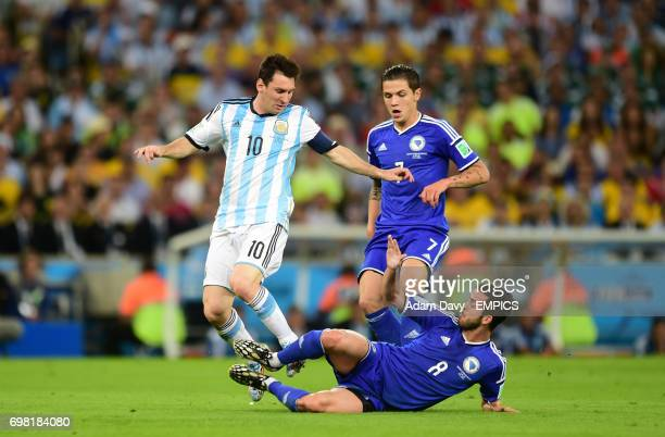Argentina's Lionel Messi and Bosnia and Herzegovina's Miralem Pjanic battle for the ball