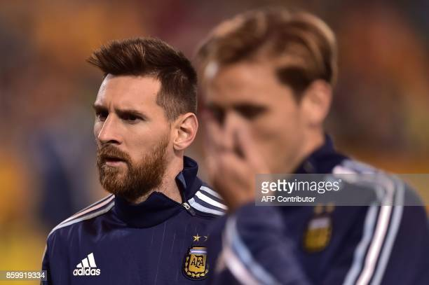 Argentina's Lionel Messi and Lucas Biglia warm up before the start of the 2018 World Cup qualifier football match against Ecuador in Quito on October...