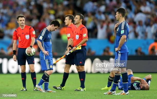Argentina's Lionel Messi and Martin Demichelis stand dejected after the game
