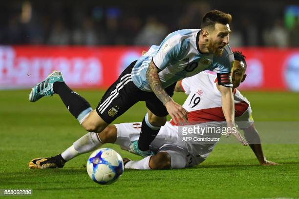 Argentina's Lionel Messi and Peru's Victor Yotun vie for the ball during their 2018 World Cup qualifier football match in Buenos Aires on October 5...