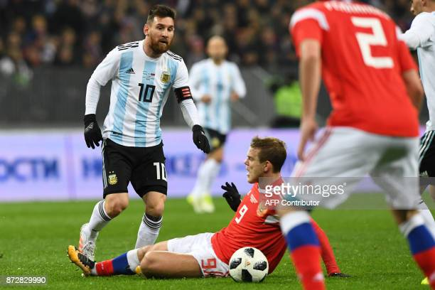Argentina's Lionel Messi and Russia's forward Alexander Kokorin vie for the ball during an international friendly football match between Russia and...