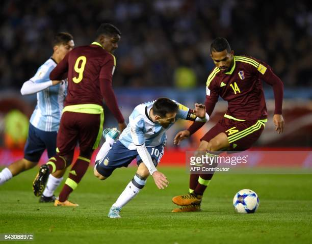 Argentina's Lionel Messi and Venezuela's Yangel Herrera vie for the ball during their 2018 World Cup qualifier football match in Buenos Aires on...