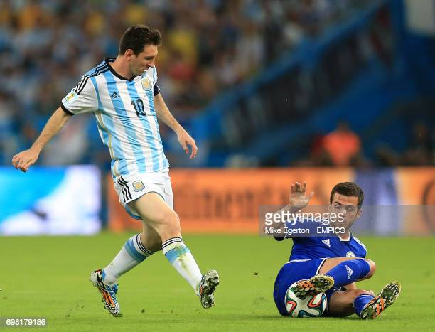Argentina's Lionel Messi battles for the ball with BosniaHerzegovina's Miralem Pjanic