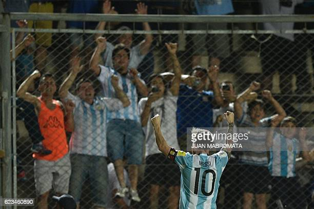 TOPSHOT Argentina's Lionel Messi celebrates after scoring against Colombia during their 2018 FIFA World Cup qualifier football match in San Juan...