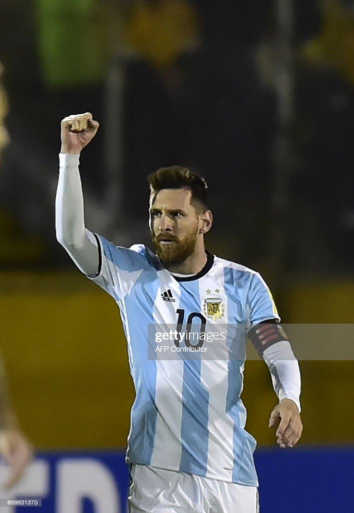 Argentina's Lionel Messi celebrates after scoring against Ecuador during their 2018 World Cup qualifier football match in Quito, on October 10, 2017. / AFP PHOTO / Rodrigo BUENDIA