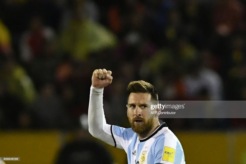 TOPSHOT - Argentina's Lionel Messi celebrates after scoring against Ecuador during their 2018 World Cup qualifier football match in Quito, on October 10, 2017. / AFP PHOTO / Juan Ruiz