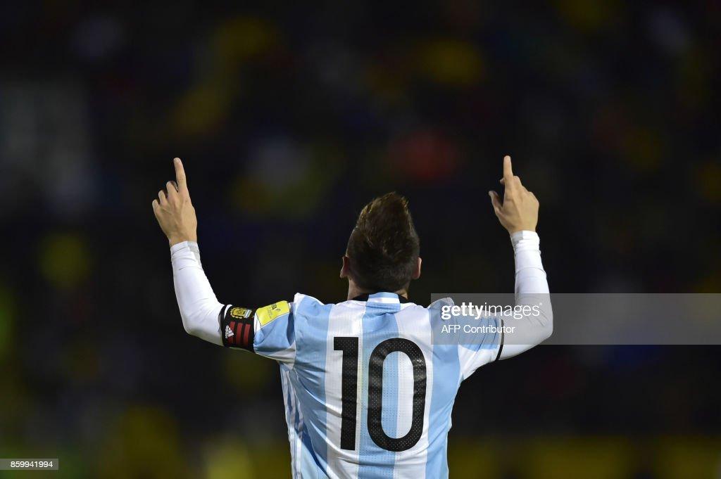 TOPSHOT - Argentina's Lionel Messi celebrates after scoring his third goal against Ecuador during their 2018 World Cup qualifier football match in Quito, on October 10, 2017. / AFP PHOTO / Rodrigo BUENDIA
