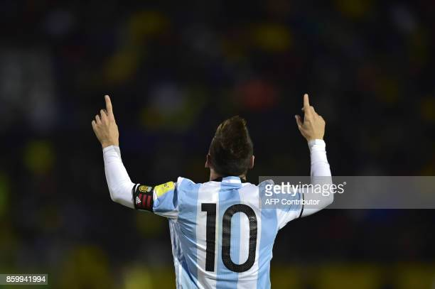 TOPSHOT Argentina's Lionel Messi celebrates after scoring his third goal against Ecuador during their 2018 World Cup qualifier football match in...