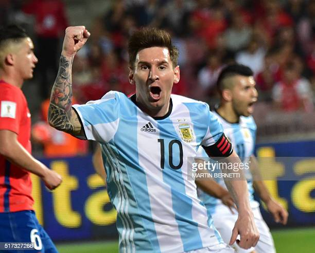 Argentina's Lionel Messi celebrates the team's second goal against Chile during their Russia 2018 FIFA World Cup South American Qualifiers' football...