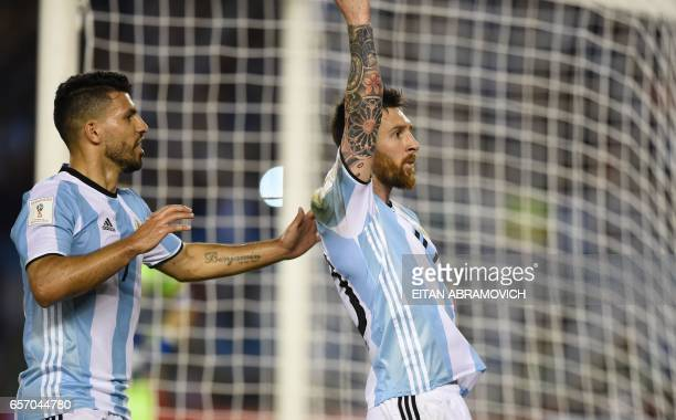 Argentina's Lionel Messi celebrates with Argentina's Sergio Aguero after scoring against Chile during their 2018 FIFA World Cup qualifier football...