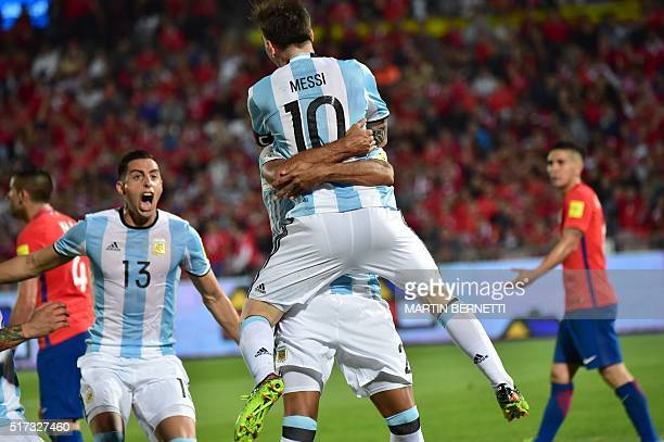 TOPSHOT Argentina's Lionel Messi celebrates with teammate Gabriel Mercado who scored against Chile during the Russia 2018 FIFA World Cup South...