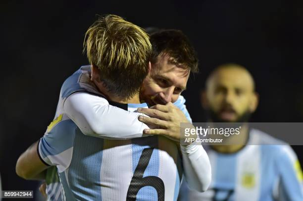 Argentina's Lionel Messi celebrates with teammate Lucas Biglia after scoring against Ecuador during their 2018 World Cup qualifier football match in...
