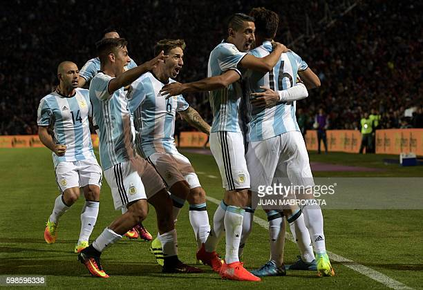 TOPSHOT Argentina's Lionel Messi celebrates with teammates after scoring against Uruguay during the FIFA World Cup 2018 qualifier football match...