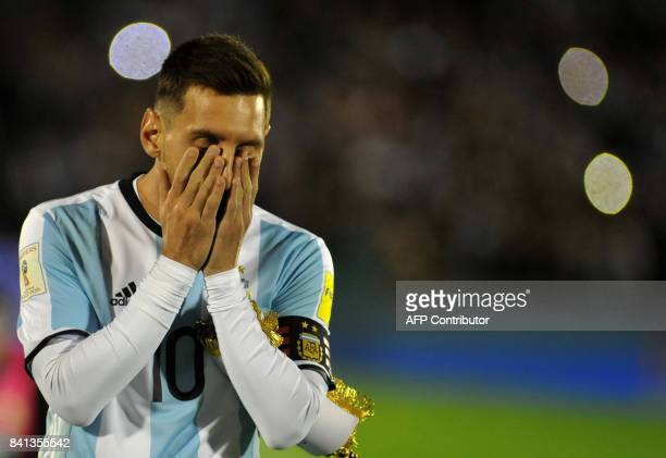 TOPSHOT Argentina's Lionel Messi gestures at the end of the 2018 World Cup qualifier football match against Uruguay in Montevideo on August 31 2017...